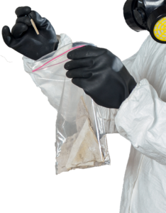 Collecting ACMs sample by asbestos technician