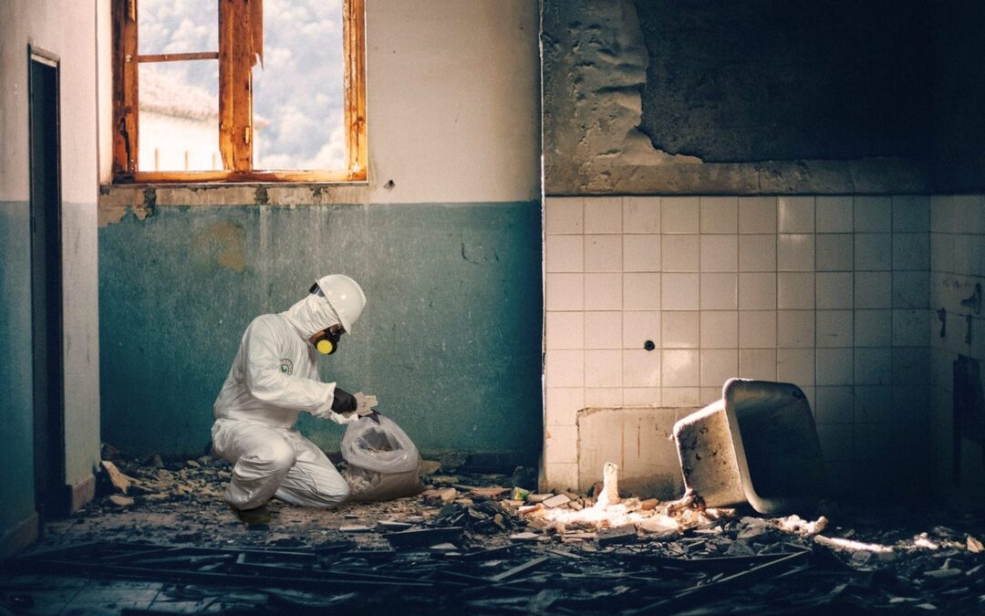 Asbestos material cleaning by asbestos technician